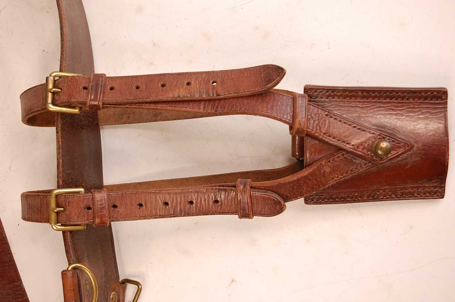 A brown leather and brass mounted Sam Browne belt with cross strap and sword frog. - Image 2 of 2