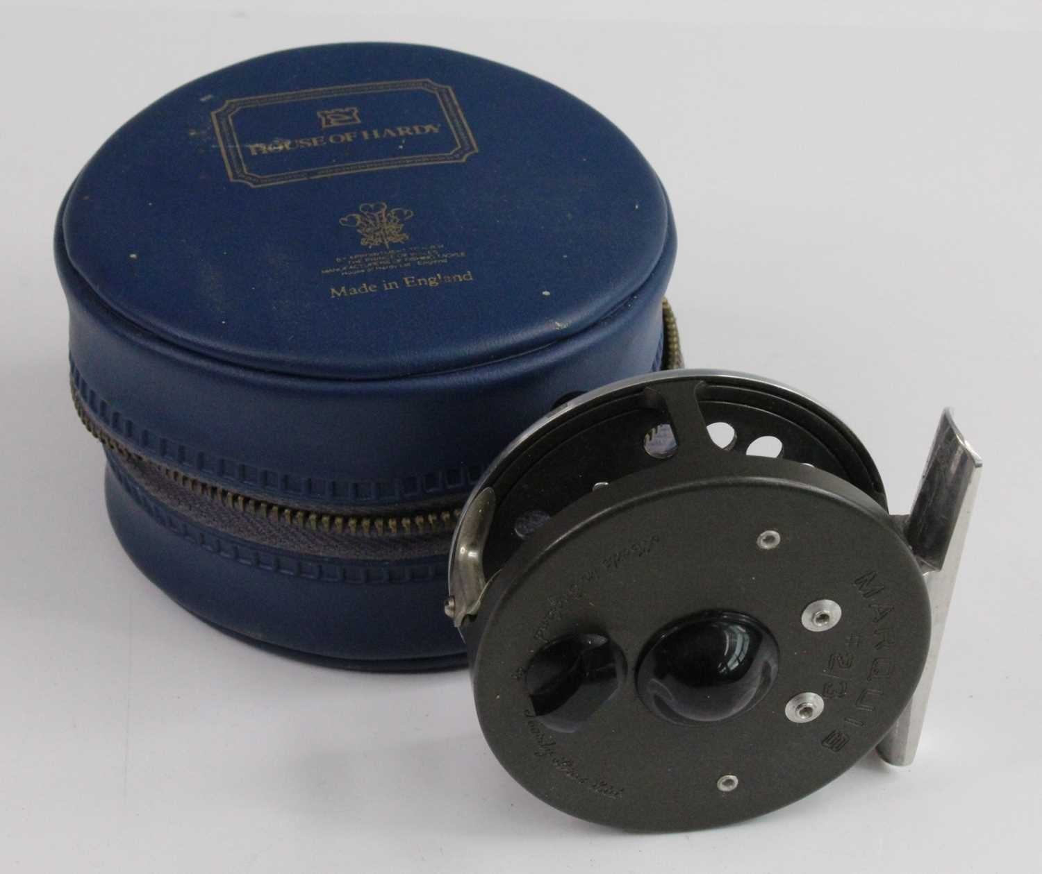 """A Hardy Marquis #2/3 2 1/2"""" centre pin fly reel, in H of H blue leather pouch."""