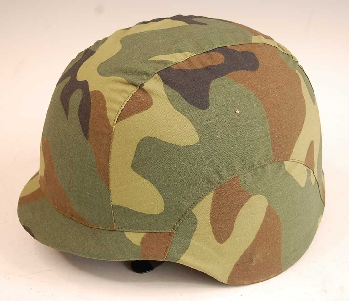 A Chinese Peoples Liberation Army composite helmet, having a leather liner, canvas chin strap and
