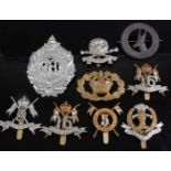 A collection of cap badges, buttons and insignia to include 16th Queen's Lancers, 9th Queen's