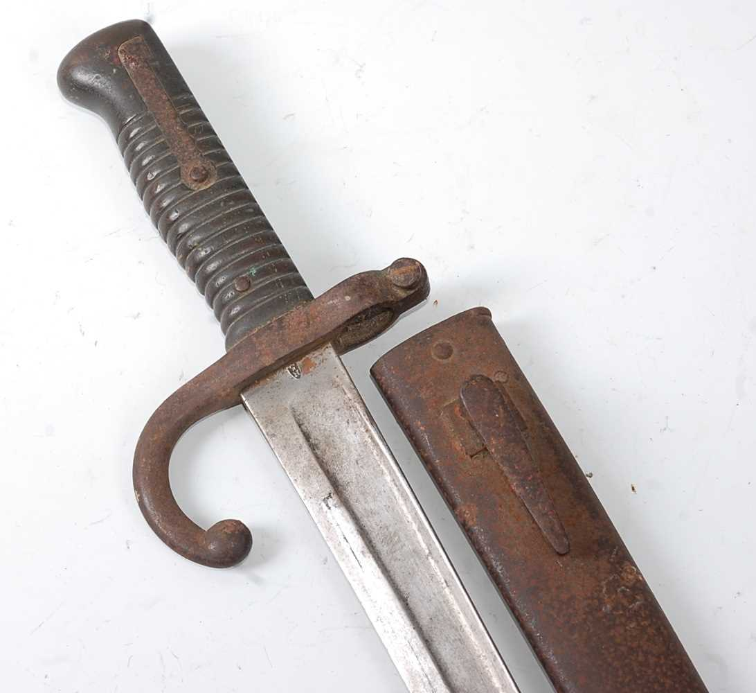 A French M1866 chassepot bayonet, the 57cm singled edged fullered Yataghan shaped blade marked to