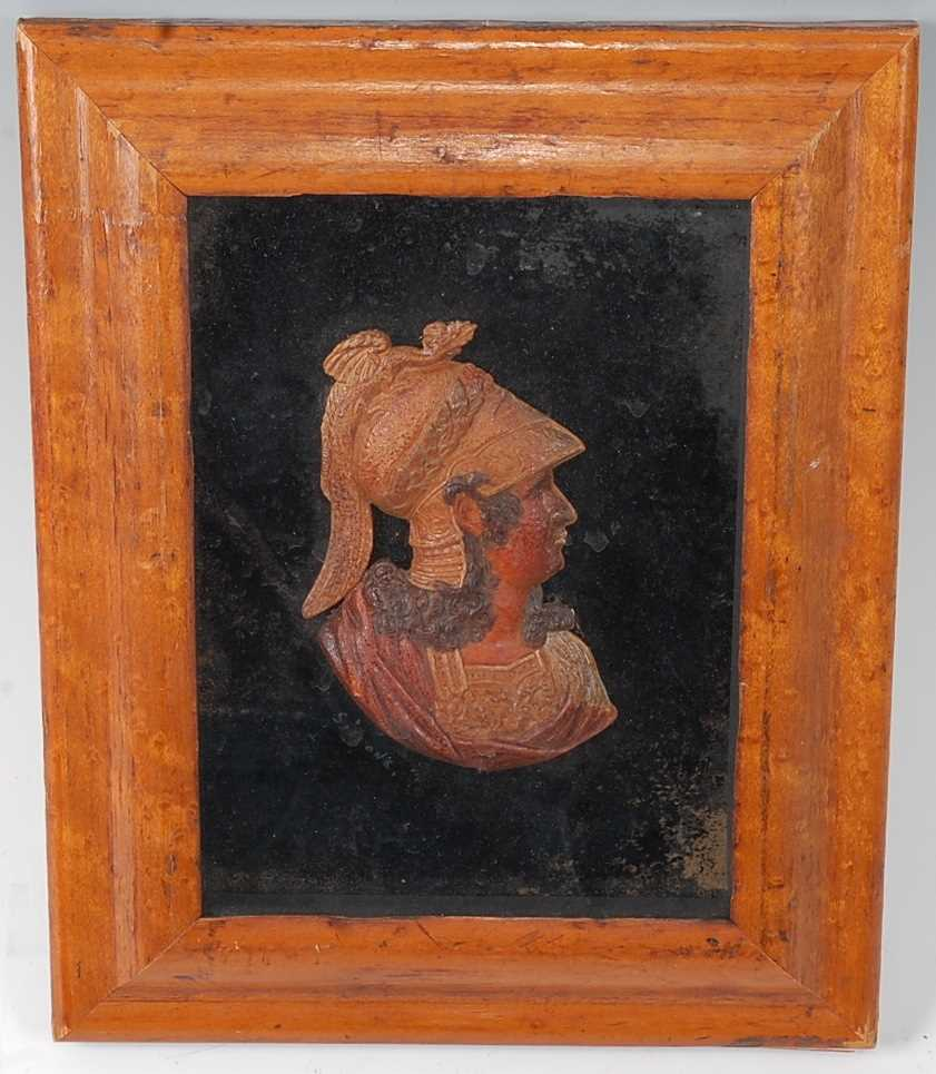 A 19th century wax head and shoulders portrait bust of a soldier, housed in a maple frame, bust 11 x