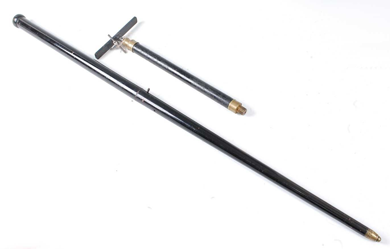 A Victorian air cane, in two sections with turned ebonised wooden handle and brass tip, no visible