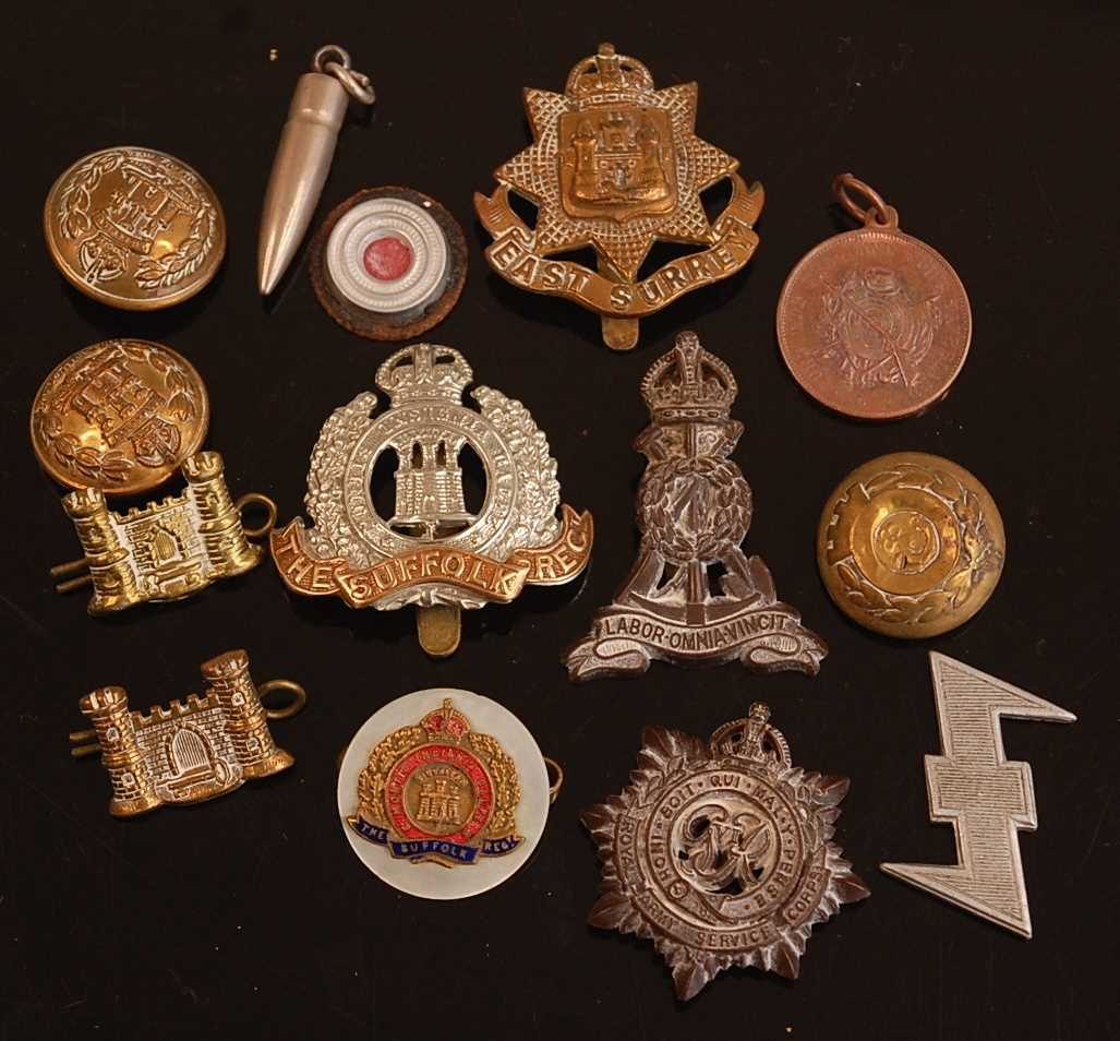 A collection of cap badges and buttons to include Suffolk Regiment, Norfolk Regiment, York and - Image 2 of 2