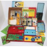 Two boxes containing a quantity of mixed issue Meccano spare parts, components, and empty boxes to