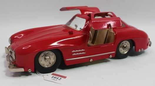 Marklin, large scale tinplate clockwork Mercedes 300SL Sports Car, red, opening gull-wing doors,