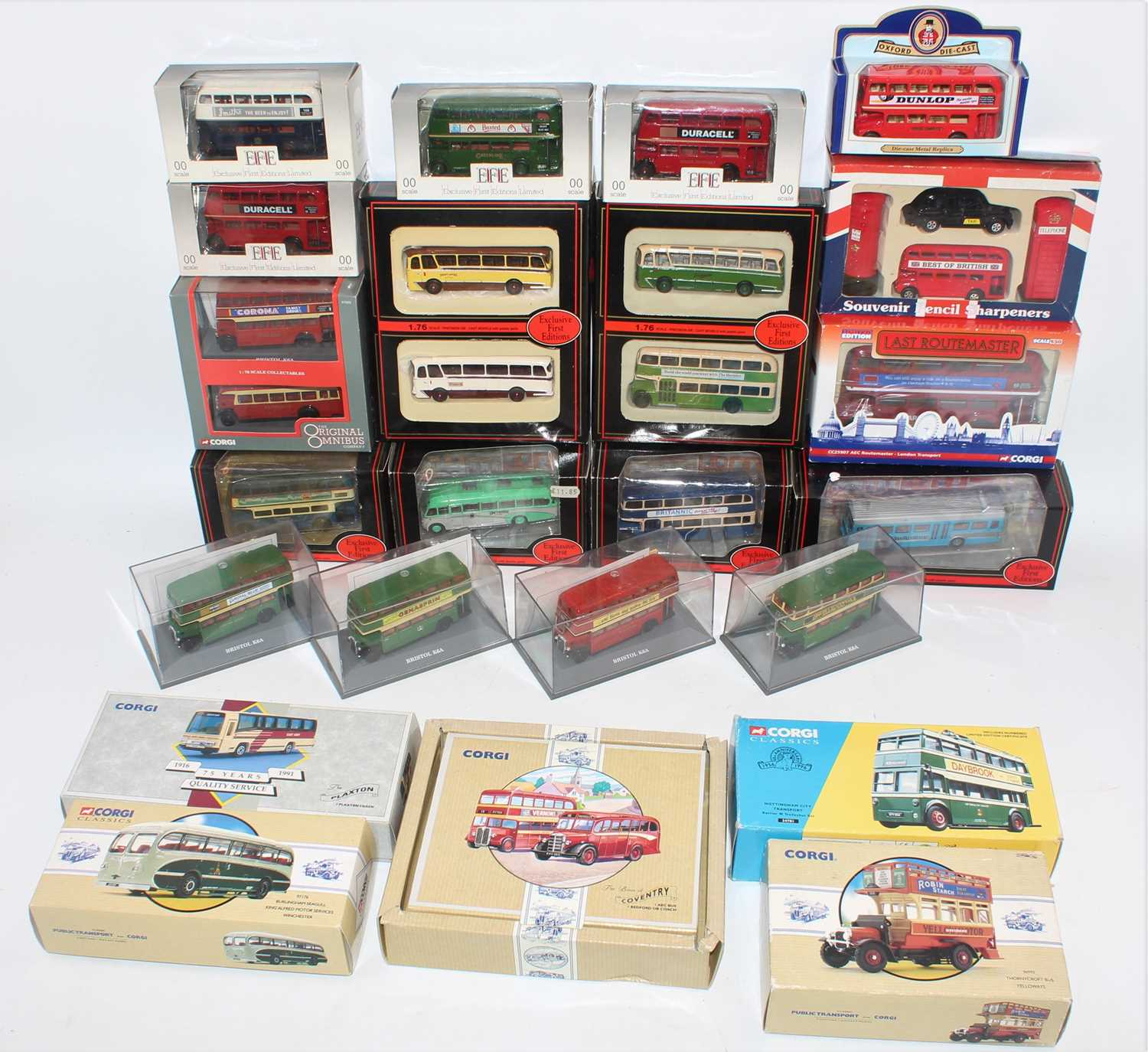 Three trays containing a large quantity of various mixed scale diecast public transport models to