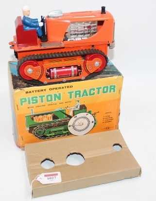 TN Toys Nomura, tinplate and battery operated model of a Piston Tractor, finished in orange with - Image 2 of 2