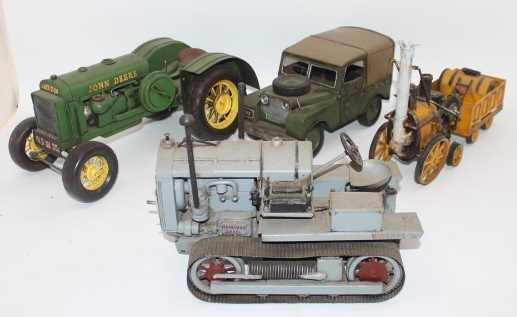 4 various reproduction Tinplate/Pressed Metal models to include John Deere Tractor, Land Rover,