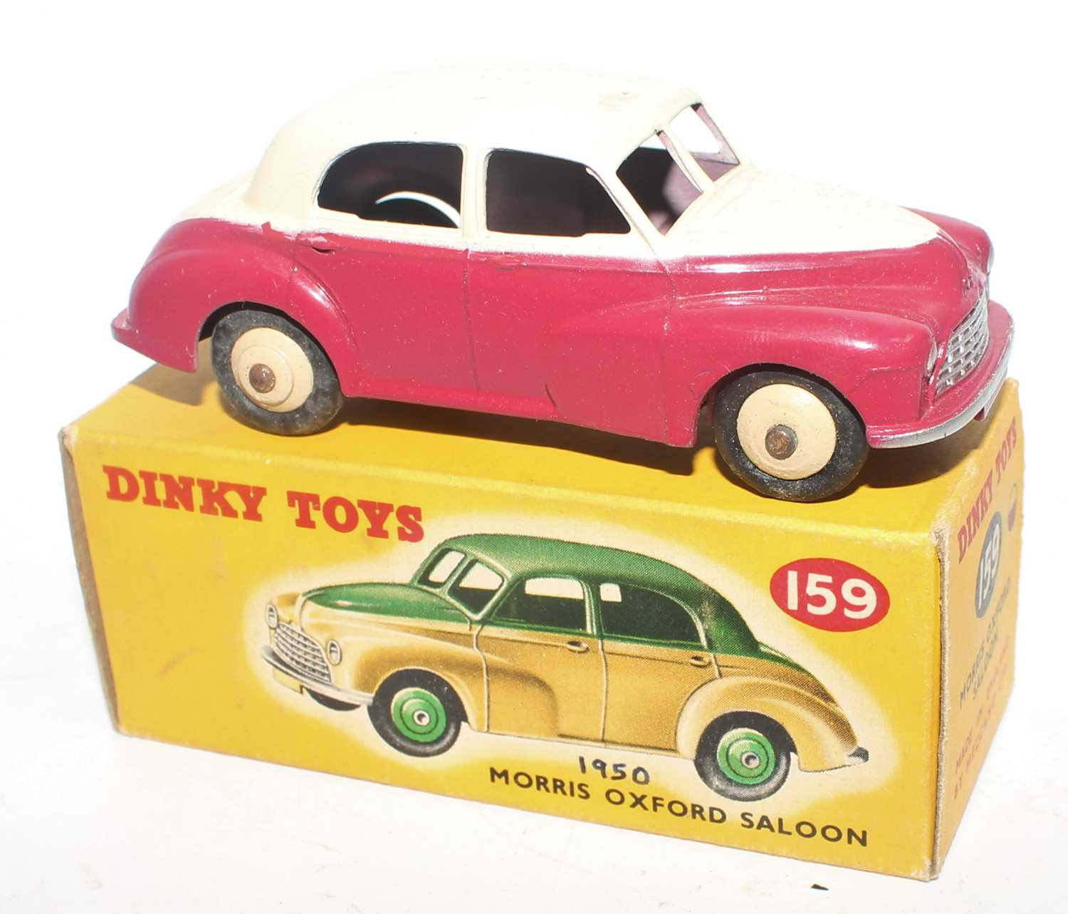 Dinky Toys No. 159 Morris Oxford saloon comprising of cream upper body with cerise lower body and - Image 2 of 2