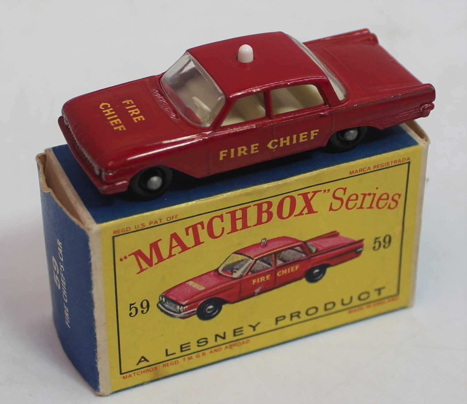 Matchbox Series No.59 Ford Fairlane Fire Chief's Car. In red with cream interior, white light to - Image 2 of 2