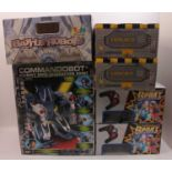 Six various boxed modern release plastic and battery-operated children's robots, to include an MGA