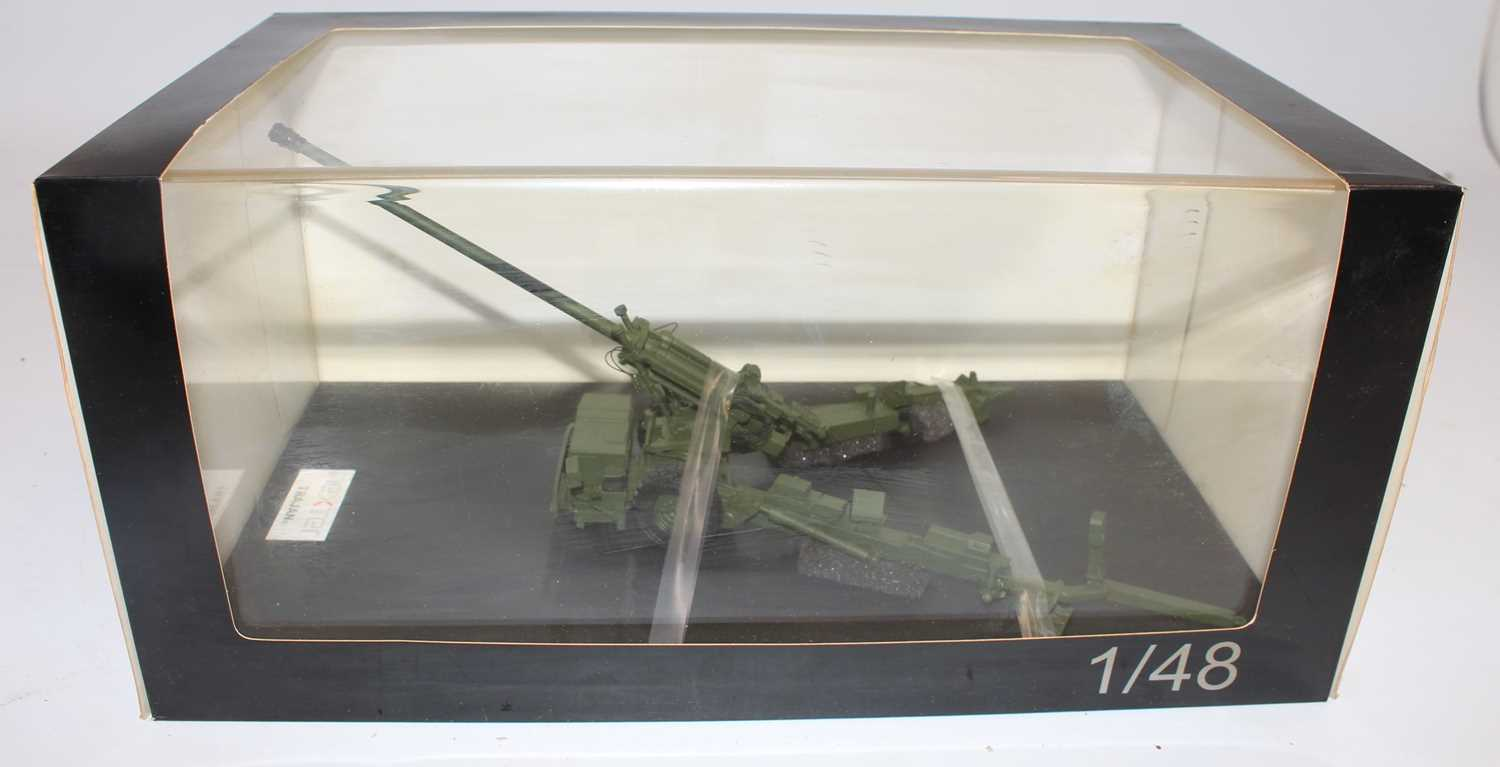 A Nexter model No. 48579V 1/48 scale resin factory hand built model of a Trajan field gun, housed in
