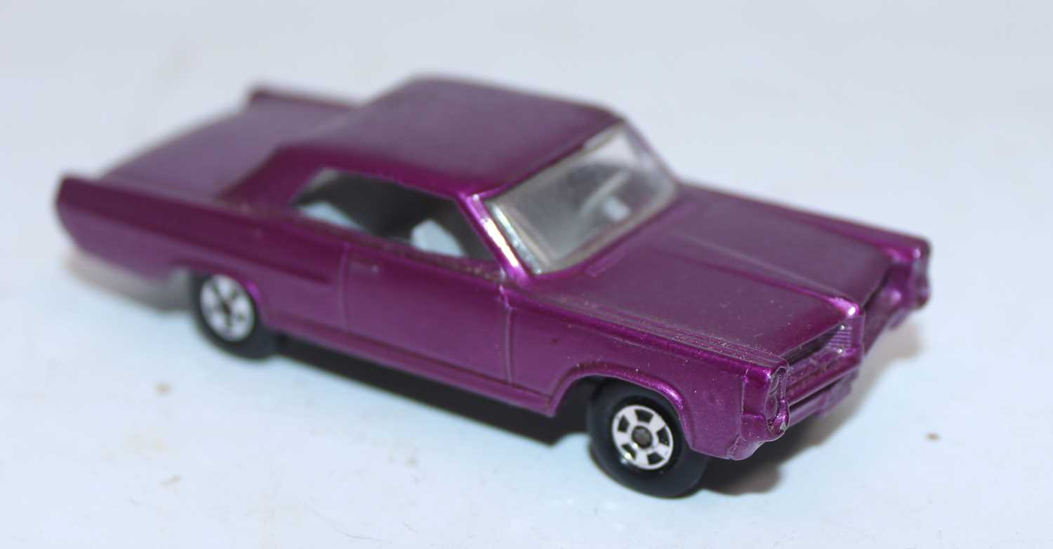 Matchbox Superfast Series No.22 Pontiac Grand Prix in deep purple with solid filled-in wheel hubs, - Image 2 of 2