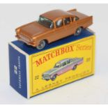 A Matchbox No.22 1958 Vauxhall Cresta comprising of metallic copper body with black base and