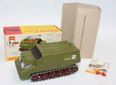 A Dinky Toys 353 U.F.O Shado 2 Mobile in green with white interior, brown rollers, silver tracks,