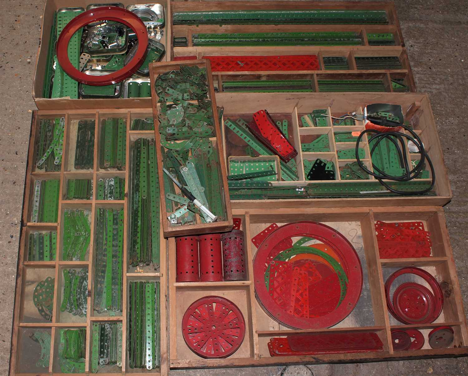 Five trays/boxes containing a number of various 1950s to 1980s red, green, and base metal Meccano