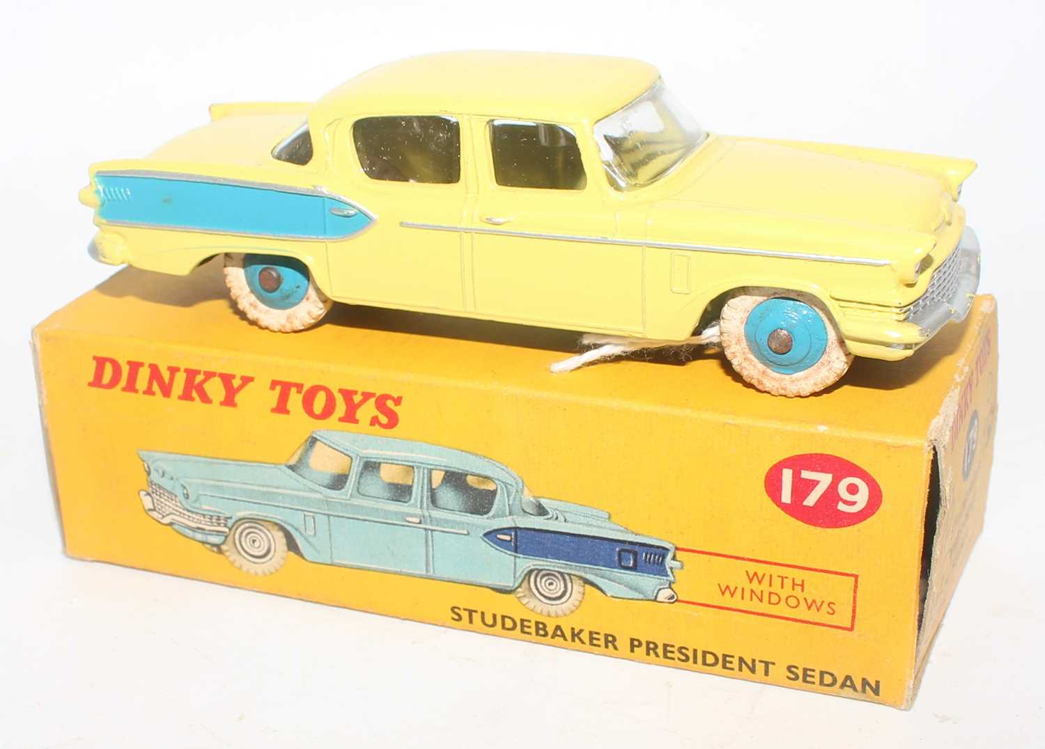 A Dinky Toys No. 179 Studebaker President sedan comprising of yellow and blue body with white - Image 2 of 2