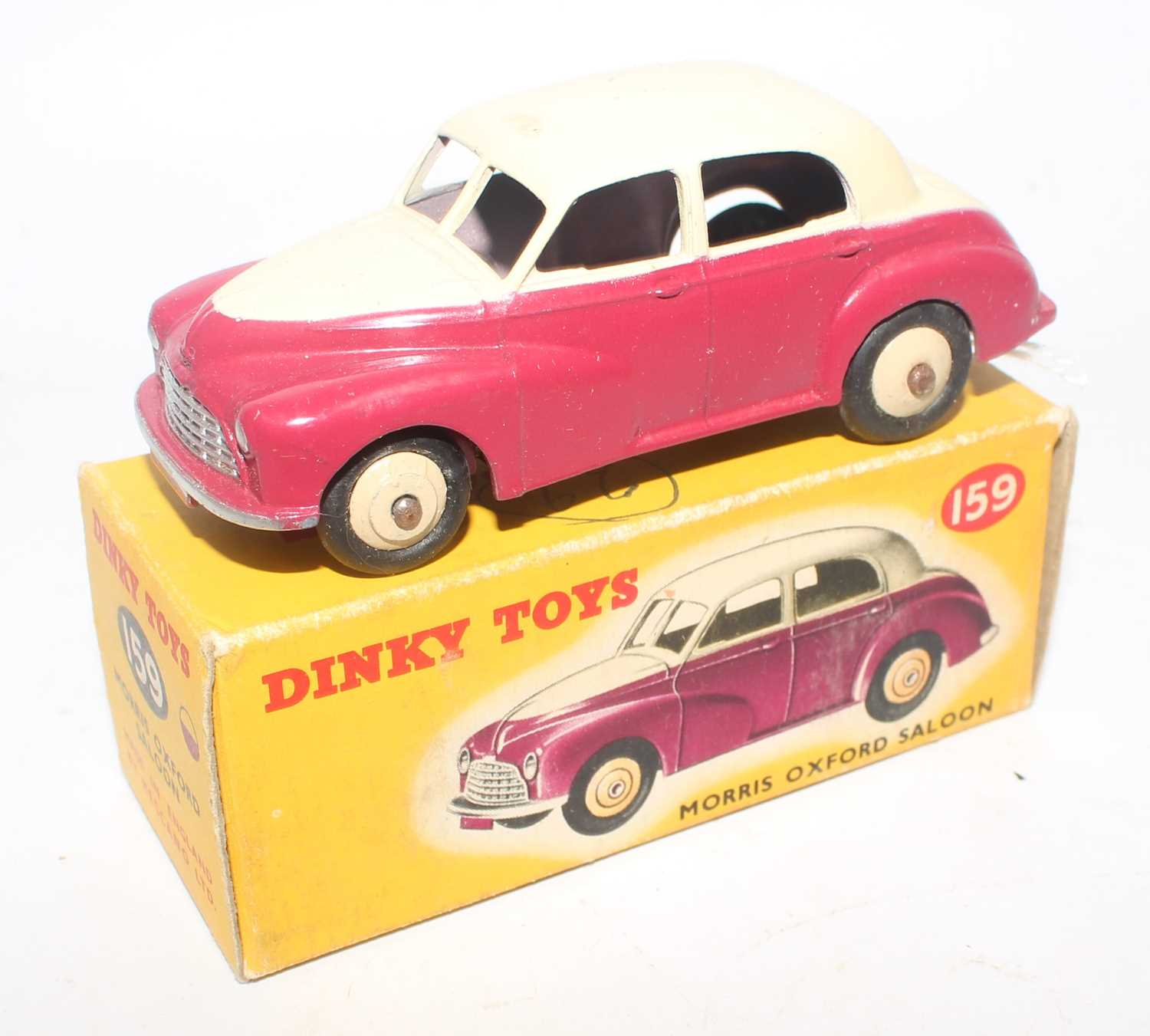 Dinky Toys No. 159 Morris Oxford saloon comprising of cream upper body with cerise lower body and