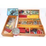 A wooden collectors' chest containing a quantity of mixed issue Meccano to include various 1950s