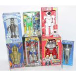One box containing seven various boxed mixed issue plastic and battery-operated robots, some