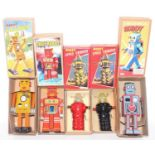 A group lot of 5 tin plate space robotic themed modern robots as follows, Robot Space Trooper x2,