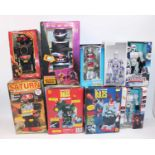 Nine various boxed battery operated and clockwork tinplate and plastic robots and space toys,