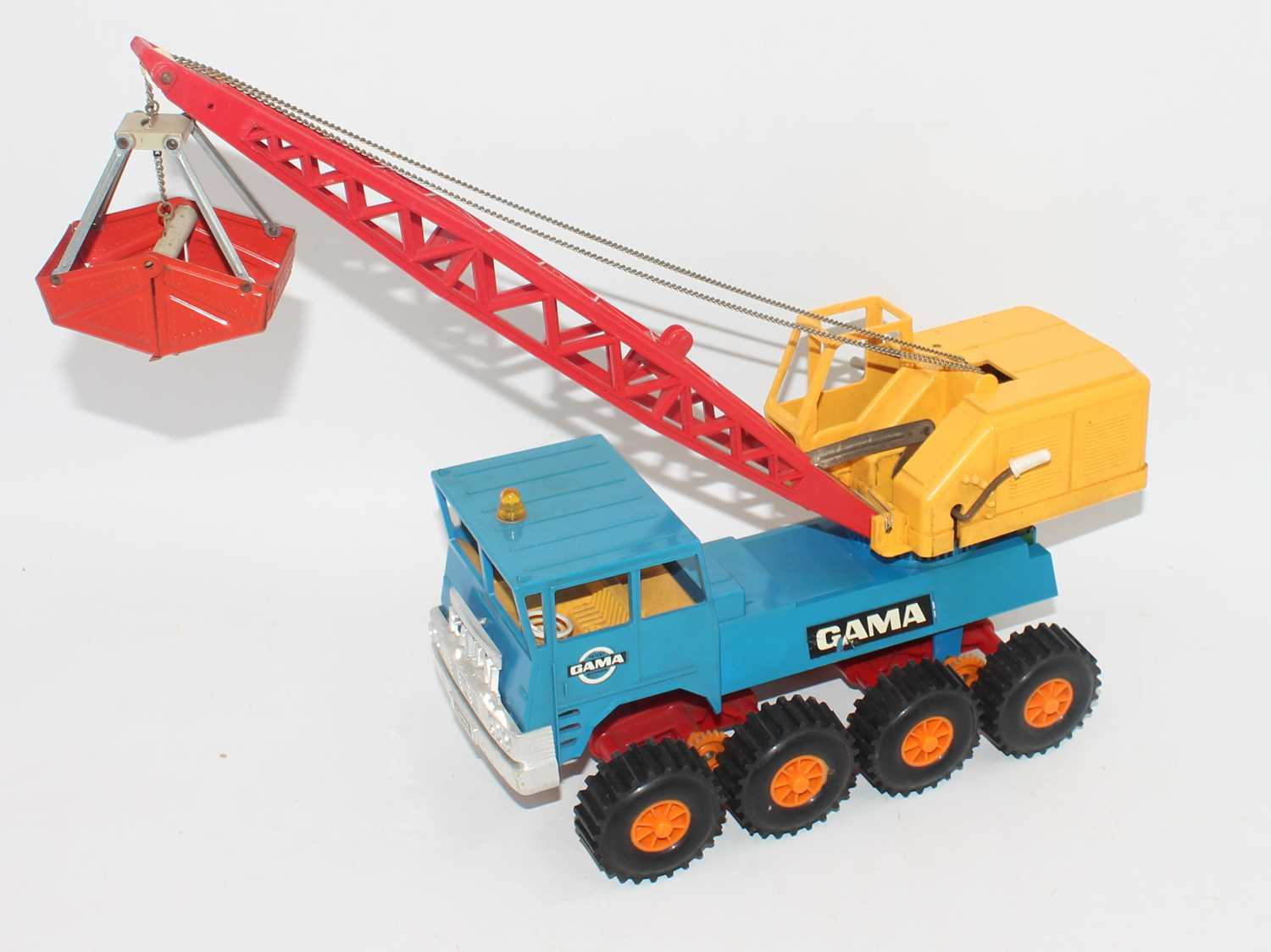 A Gama of West Germany, tinplate and plastic model of a Faun 8x8 heavy-duty crane, comprising a