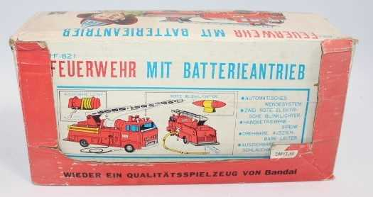 Bandai, tinplate and battery operated model of a IF-821 Fire Engine, finished in red and silver,