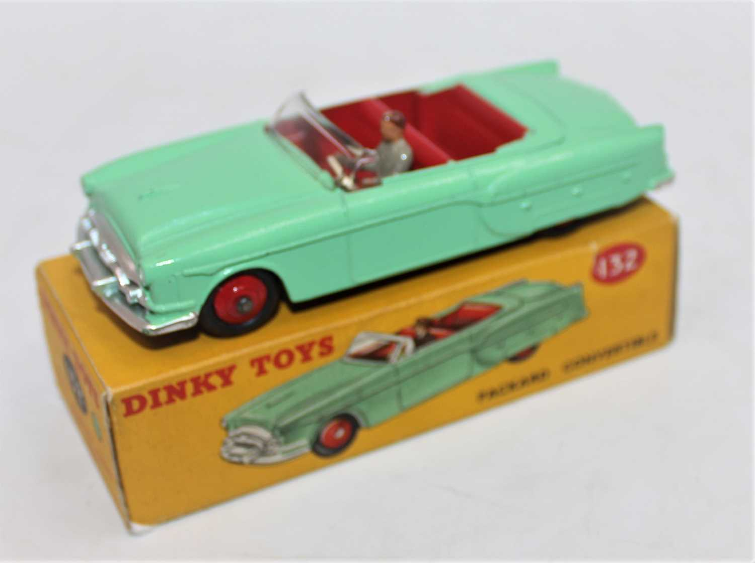 Dinky Toys 132 Packard Convertible with green body, red interior and hubs and driver comes with