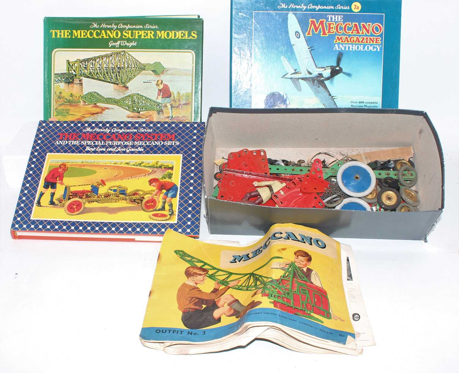 A collection of various mixed loose 1950's Meccano and hardback books, including The Hornby