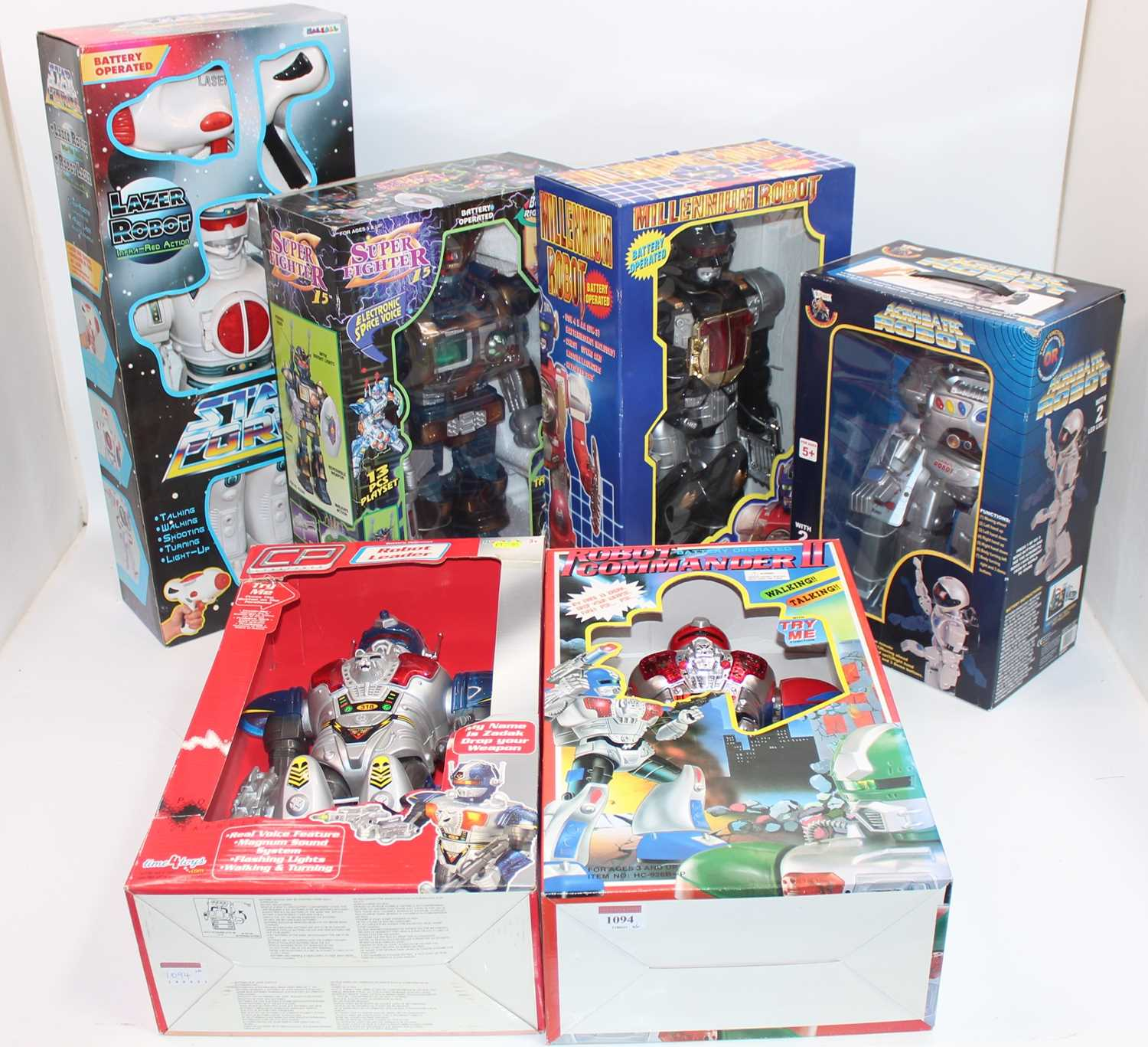 Six various boxed modern release plastic and battery operated various robots, to include a super