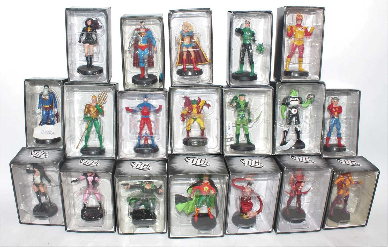 A collection of various mail-order release white metal Eagle Moss DC action figures to include a