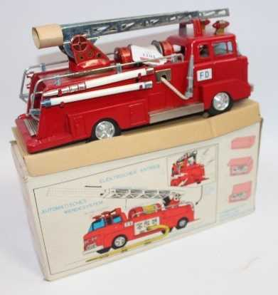 Bandai, tinplate and battery operated model of a IF-821 Fire Engine, finished in red and silver, - Image 3 of 3
