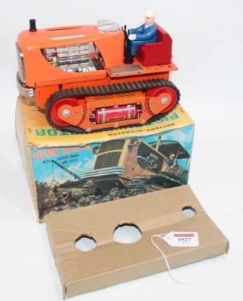 TN Toys Nomura, tinplate and battery operated model of a Piston Tractor, finished in orange with