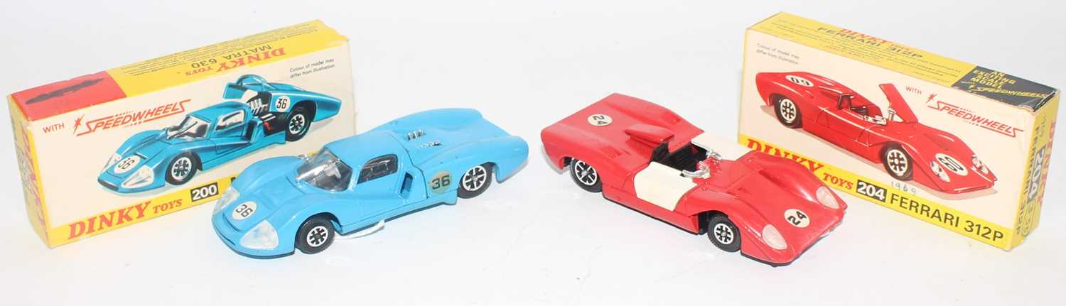 Dinky Toys boxed racing car diecast group to include a No. 204 Ferrari 312P comprising of red and