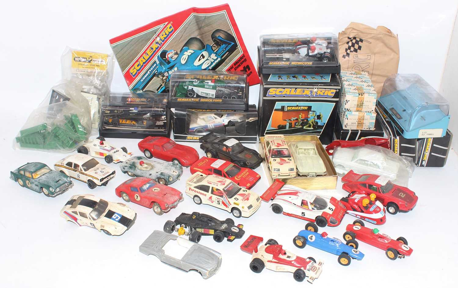 Two trays containing a quantity of various Scalextric slot cars, components, spares, and repairs,