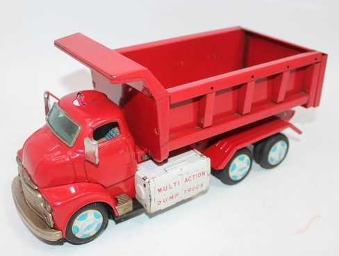 Yonezawa (Japan) battery-operated lift dump truck, comprising red cab, chassis and back, with