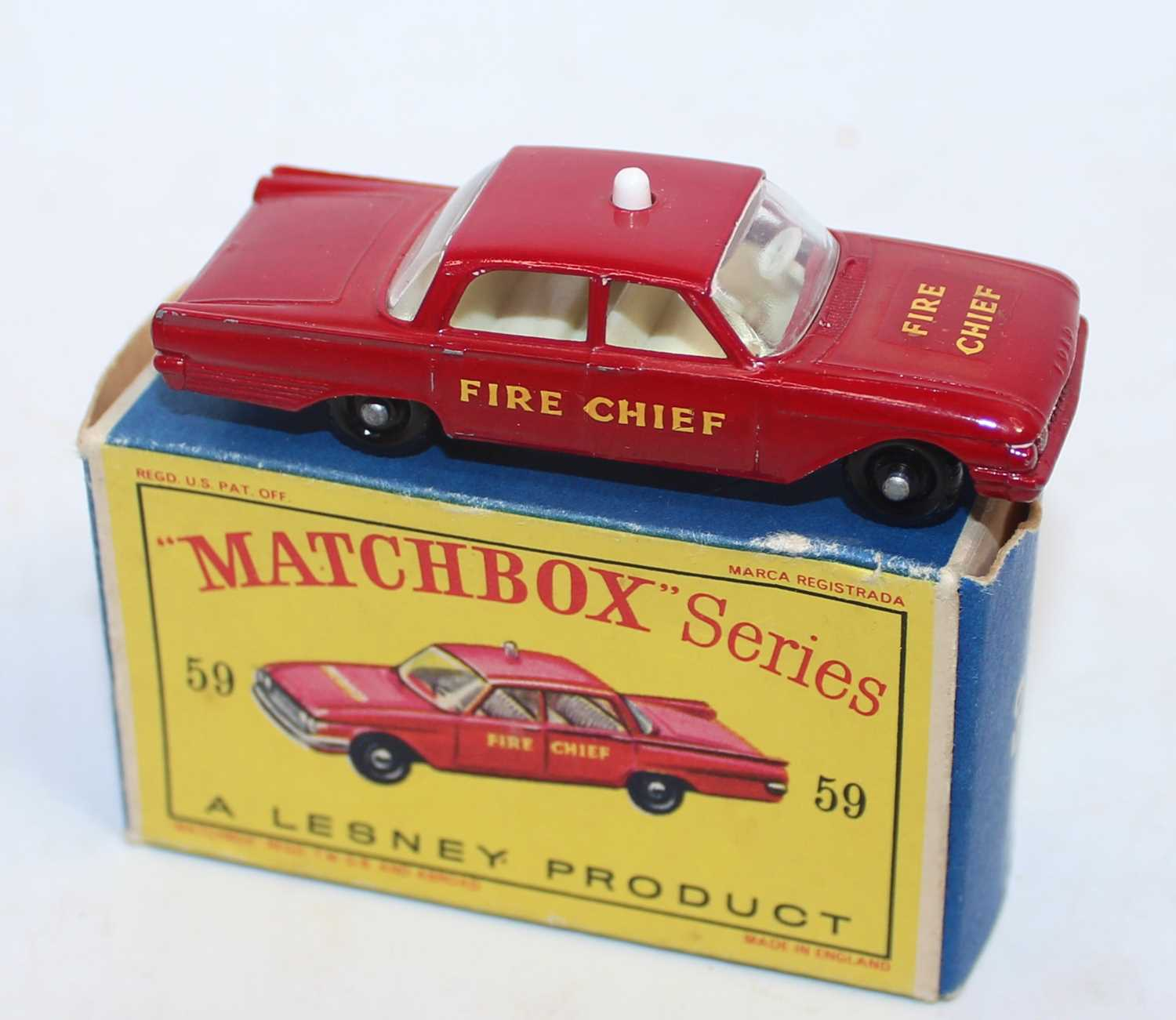 Matchbox Series No.59 Ford Fairlane Fire Chief's Car. In red with cream interior, white light to