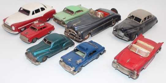 8 various loose tinplate cars and saloons, mixed manufacturers to include Gama, Mettoy, Distler