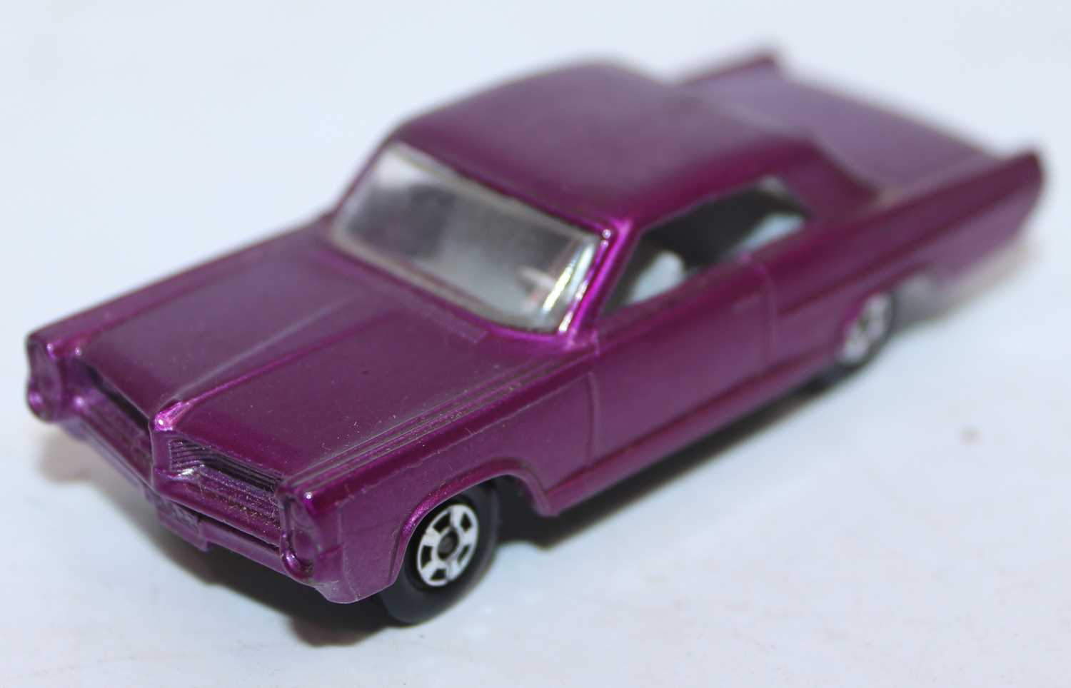 Matchbox Superfast Series No.22 Pontiac Grand Prix in deep purple with solid filled-in wheel hubs,
