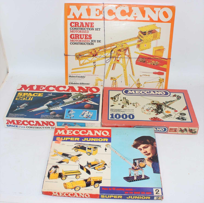 Four Meccano sets:- motorised crane set; construction set 1000, super junior set no. 2 and space