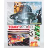 A Micro-Scalextric Quantum of Solace 007 slot racing set, together with a Tomy AFX Midnight Marathon