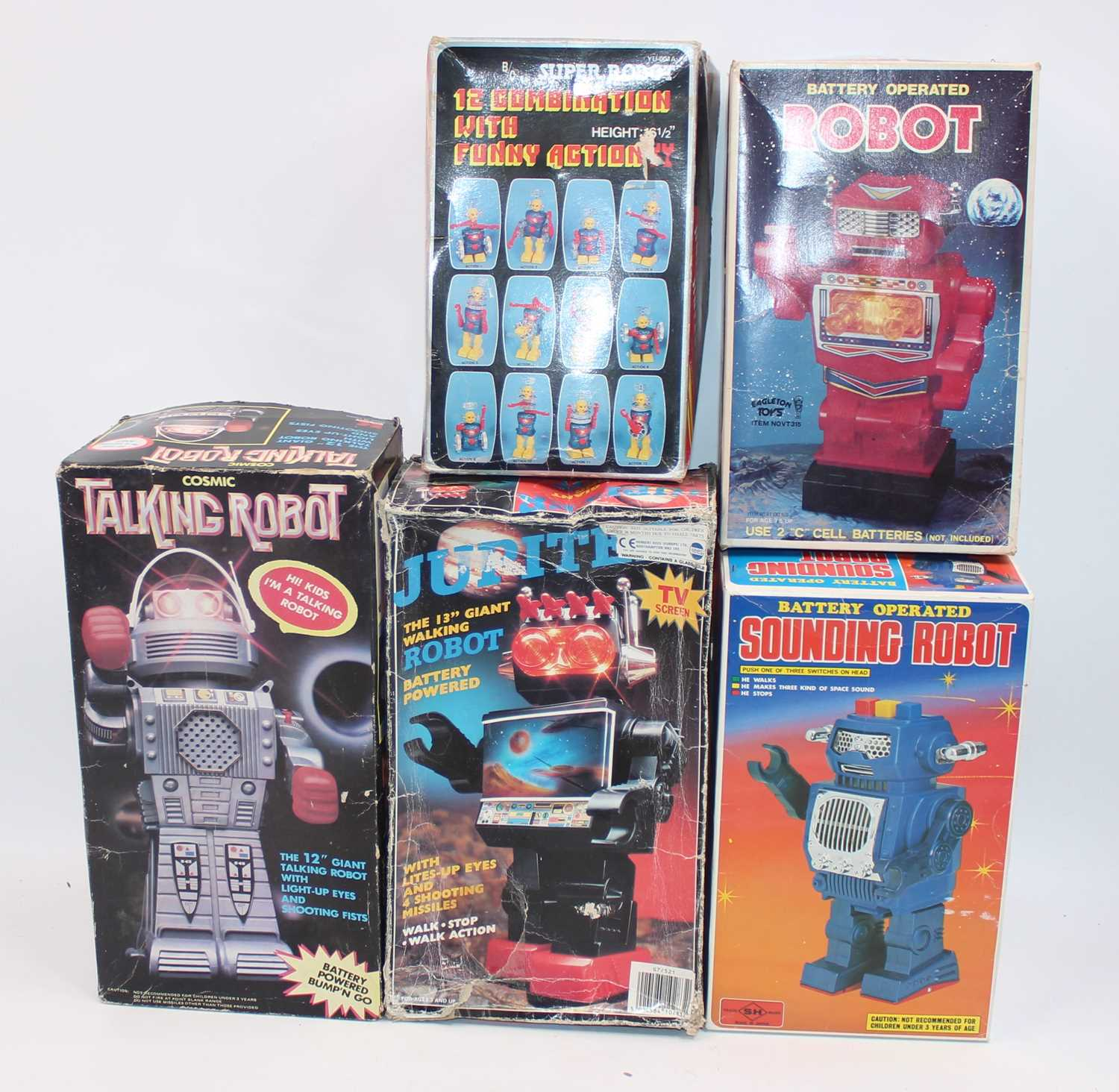 Five various boxed plastic and battery operated Chinese and Japanese robots, to include a SH Toys of