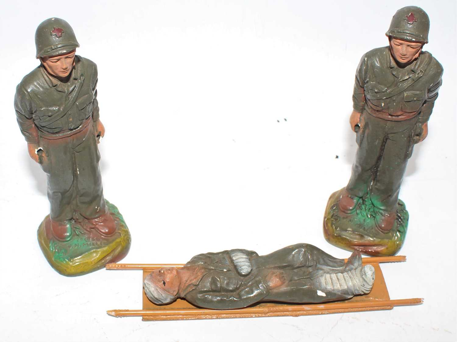 JH Miller 1950 hand-painted pottery US Army, Korean War, stretcher-bearers comprising of a
