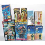 Nine various boxed reproduction tinplate, plastic, and battery-operated robots, mixed examples to