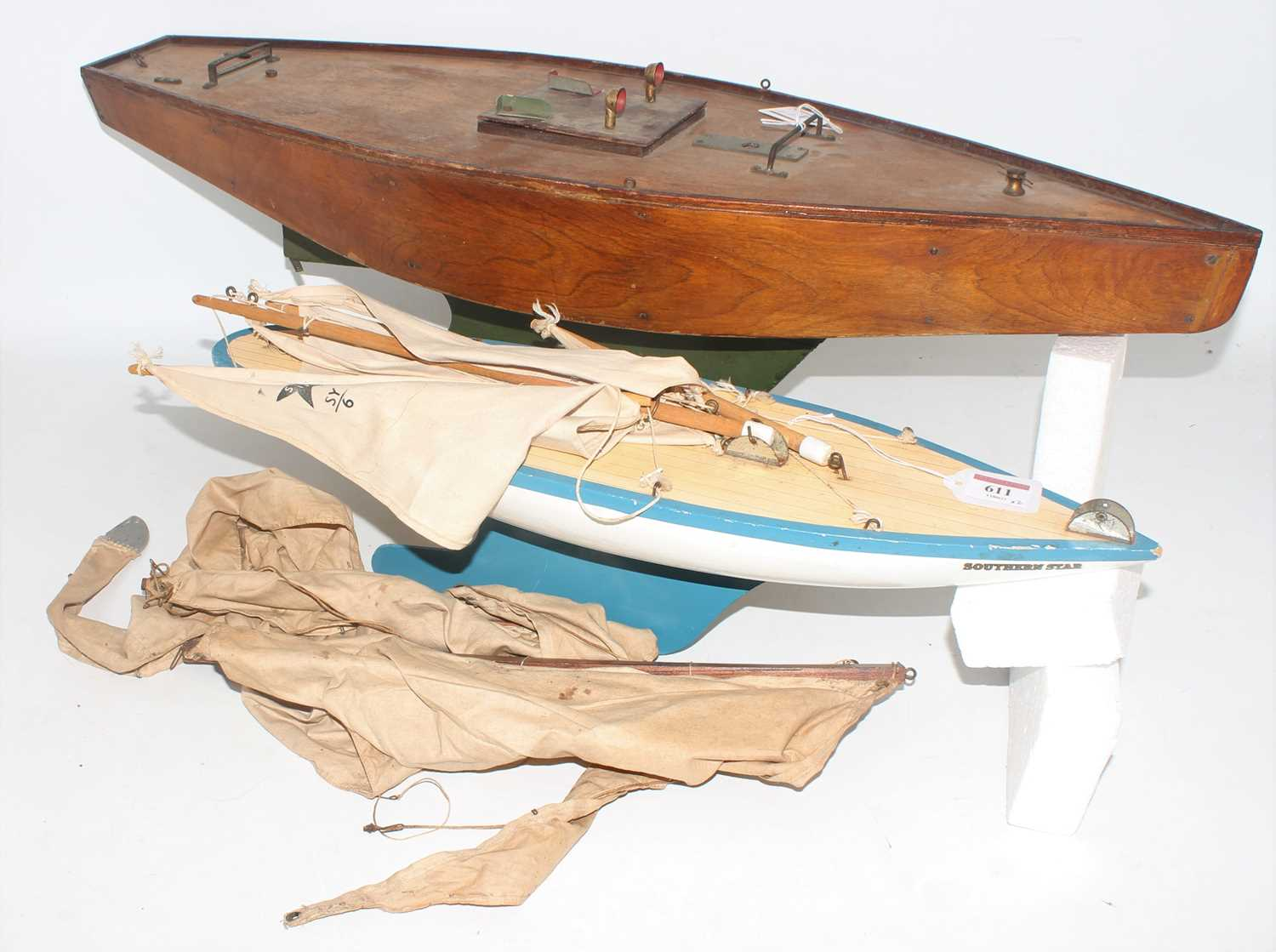 Pond Yacht group, 2 examples to include a home made wooden pond yacht with stained hull and deck,