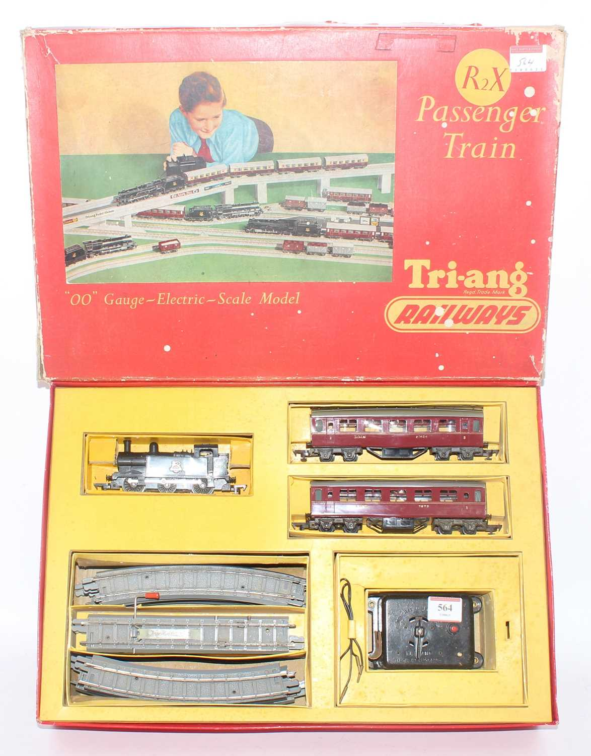 Triang R2X passenger set comprising 0-6-0 tank loco BR 47606, 2 x LMS coaches, track and battery