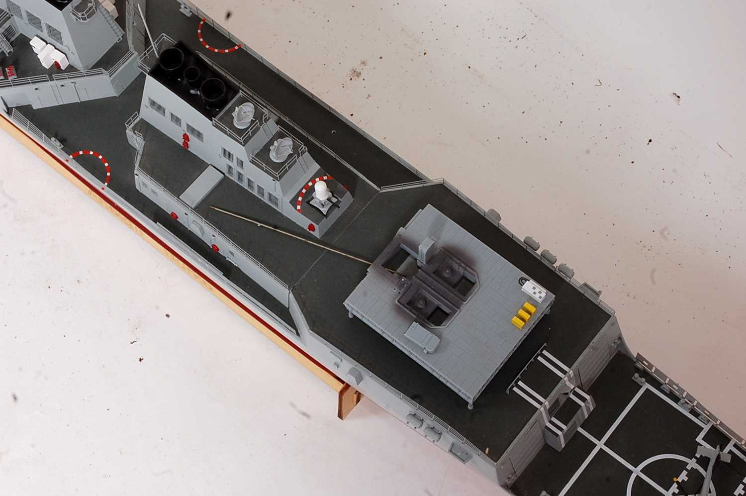 A kit built model of an Arleigh Burke No. 82 destroyer, finished in red, grey and black, with - Image 2 of 3