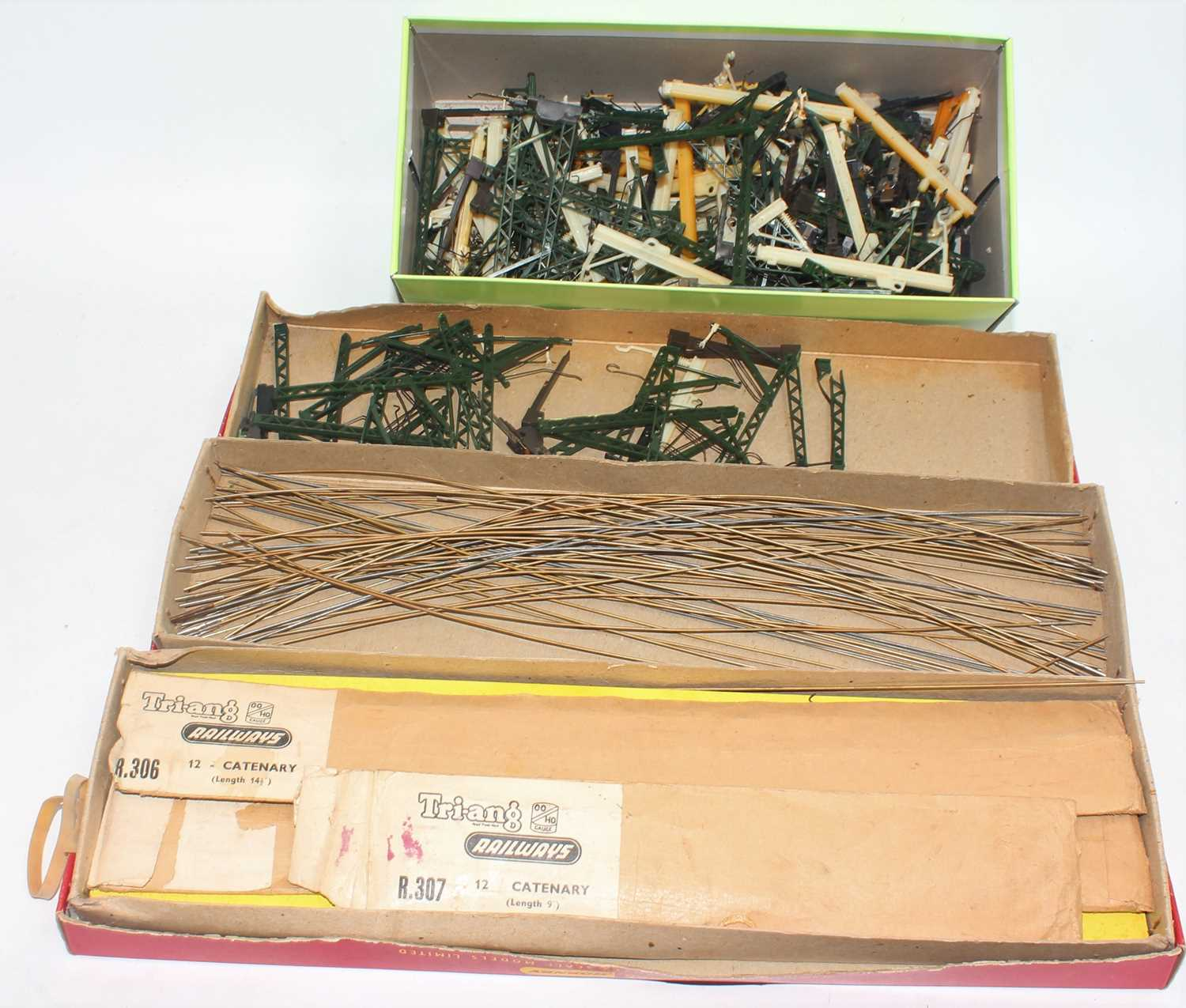 A large quantity of catenary pieces including masts and wires, most is Triang Hornby, overall (G)